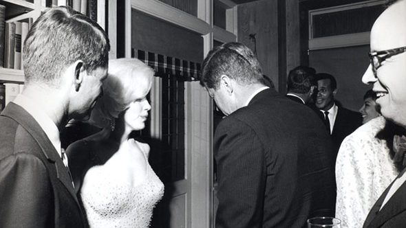 U.S. President John F. Kennedy (with his back to the camera), U.S. Attorney General Robert Kennedy (far left), and actress Marilyn Monroe, on the occasion of President Kennedy's 45th birthday celebrations at Madison Square Garden in New York